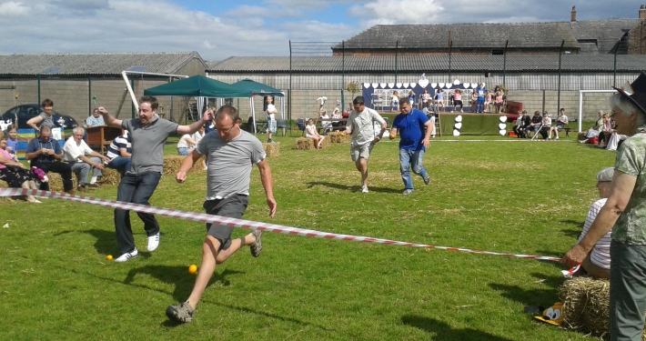 Residents racing at the village fete in Lach Dennis