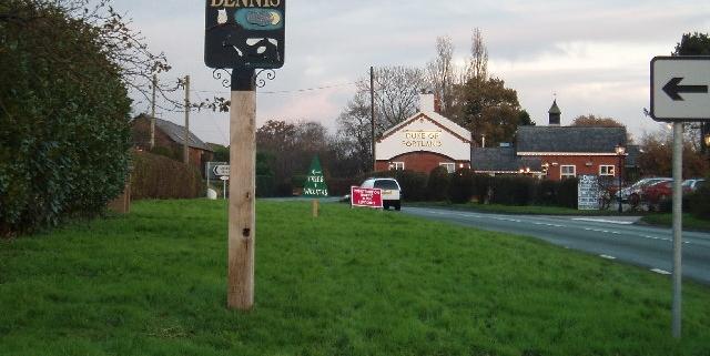 Lach Dennis Village sign