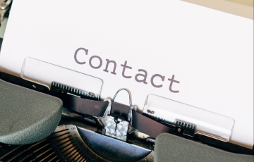 typewriter showing a letter saying 'Contact'
