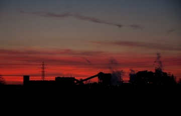 Industrial buildings against a a red sunset