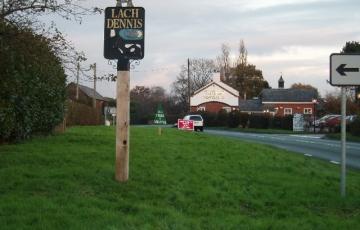 Lach Dennis village street sign
